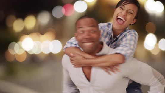 Thumbnail for A black couple embraces each other on urban city streets