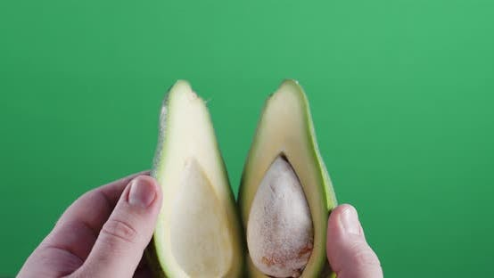 Thumbnail for Opening Fresh Halved Avocado .