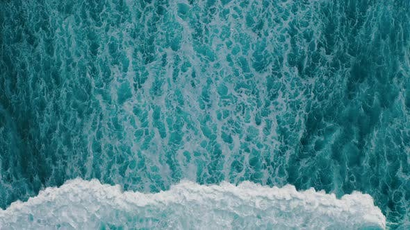 Thumbnail for Aerial View Ocean Waves Break Into Foam Along the Shore