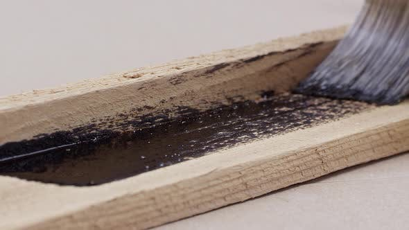 Thumbnail for View of brush painting board with stain