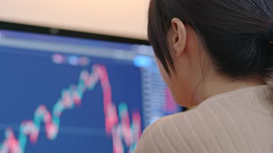 Thumbnail for Woman check on stock market data at the screen of computer