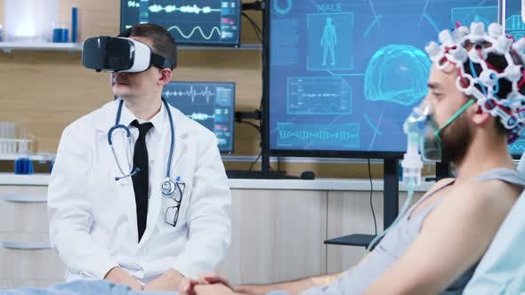Doctor in a Neuroscience Centre Wearing a Virtual Reality Goggles