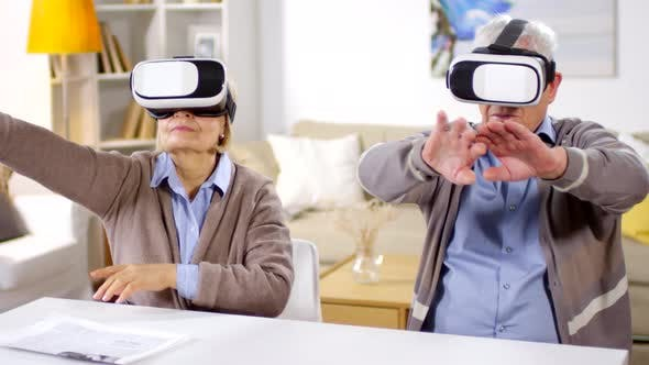 Cover Image for Aged Couple Wearing VR Glasses