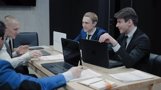 Young Businessmen are Conversation in the Office