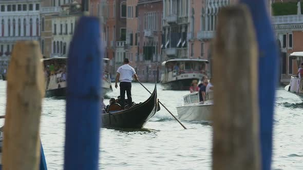 Cover Image for Waterbuses and gondolas sailing with tourists aboard across channel in Venice
