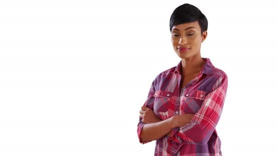 Thumbnail for Attractive black female standing with arms crossed in studio with copyspace