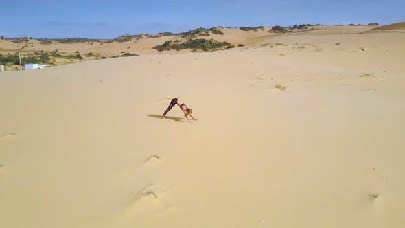 Cover Image for Strong Girl Does Yoga Among Desert Sand Panorama
