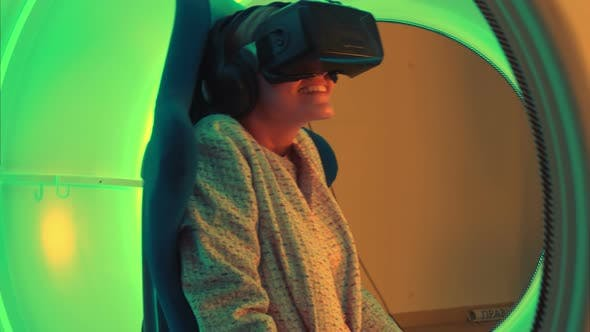 Thumbnail for Excited Young Woman Enjoying Virtual Reality Attraction