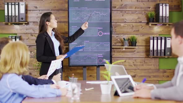 Thumbnail for Young Business Woman in Suit Having a Successful Presentation