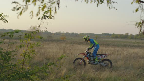 Cover Image for Riding motocross on a field