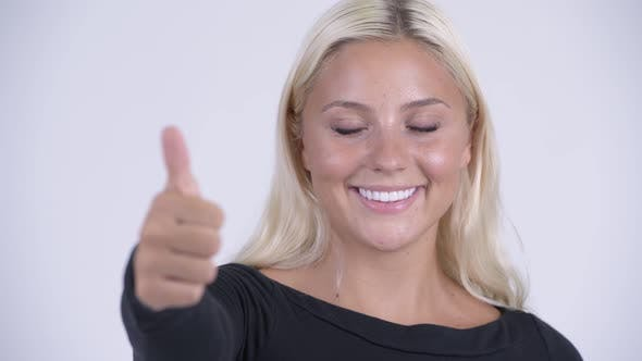 Thumbnail for Face of Young Happy Blonde Woman Giving Thumbs Up