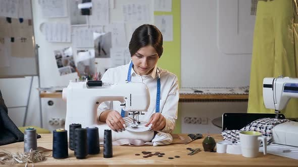 Thumbnail for Young Woman Working on Sewing Machine in the Sew Studio
