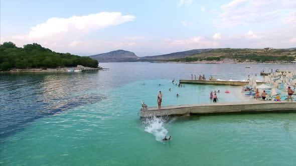 Docks at a beach with people in Albania