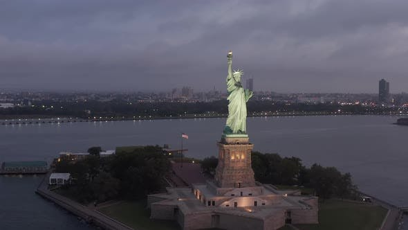 Thumbnail for Circling Statue of Liberty Beautifully Illuminated in Early Morning Light New York City
