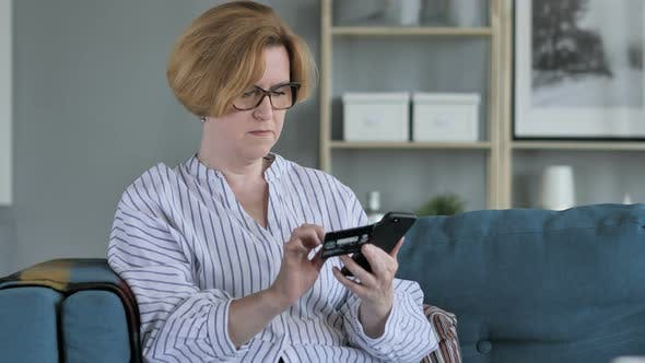 Thumbnail for Online Shopping on Smartphone by Sitting Woman