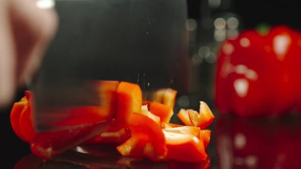 Thumbnail for Cook Cutting A Fresh Red Bell Pepper On A Black Table