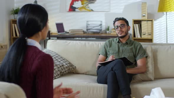 Thumbnail for Young Male Psychotherapist Listening to Woman during Therapy Session