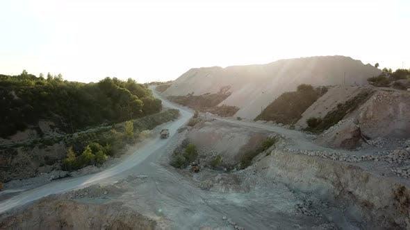 Bulldozer excavator truck, heavy duty digging stone, quarry, stone work, air view