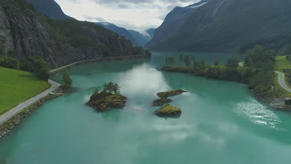 Thumbnail for Lovatnet Lake with Turquoise Water and Green Islands. Beautiful Nature of Norway. Aerial View