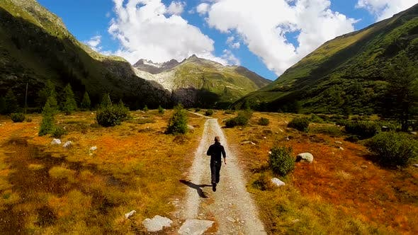 Thumbnail for Young Caucasian Male Running on Nature Road Outdoors