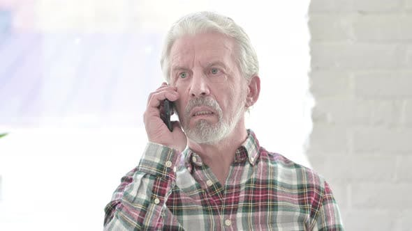 Portrait of Cheerful Casual Old Man Talking on Smartphone