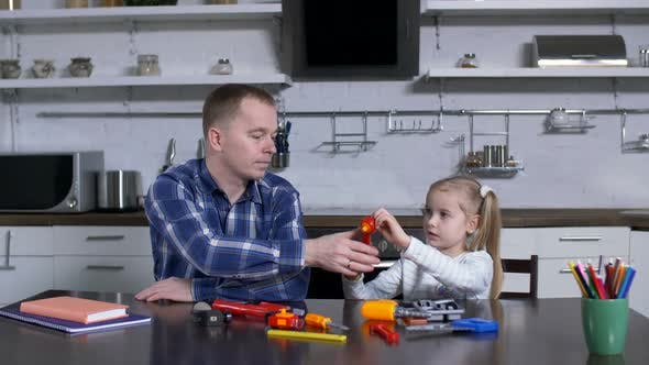 Thumbnail for Father Explaining To Preschool Girl Use of Wrench