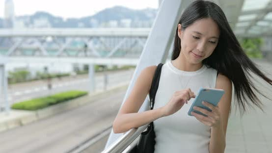 Thumbnail for Woman texting on smartphone