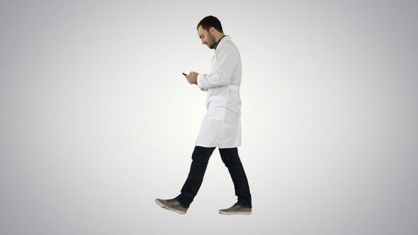 Thumbnail for Walking medical professional using smart phone and making