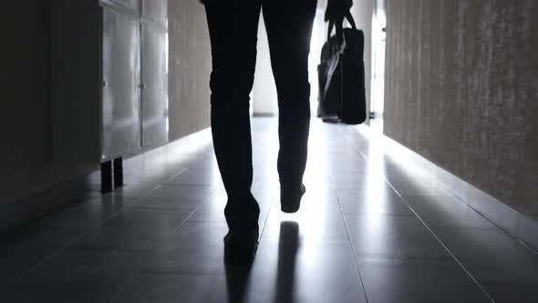 The Business Man Walks Down the Hallway to the Office