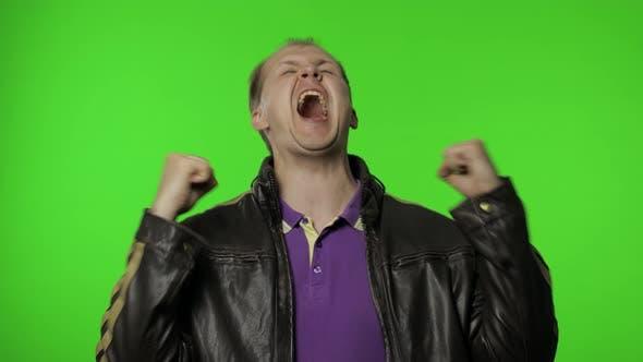 Thumbnail for Crazy Overjoyed Rocker Man on Chroma Key Raising Fists Gesturing Yes Success, Celebrating Triumph