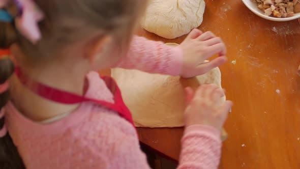 Thumbnail for Little Girl Rolling Dough Pizza