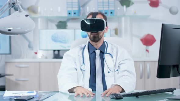 Thumbnail for Caucasian Doctor Wearing a VR Headset in His Modern Office