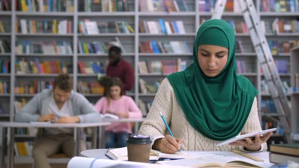 Thumbnail for Pretty Muslim Female Student Learning in Library