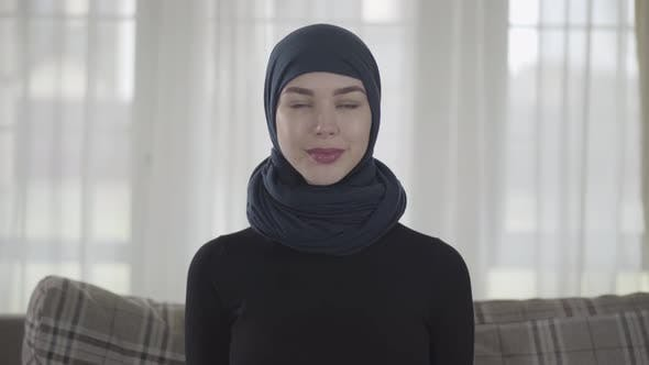 Thumbnail for Portrait of Independent Young Muslim Woman Looking Serious Confident at Camera Wearing Traditional
