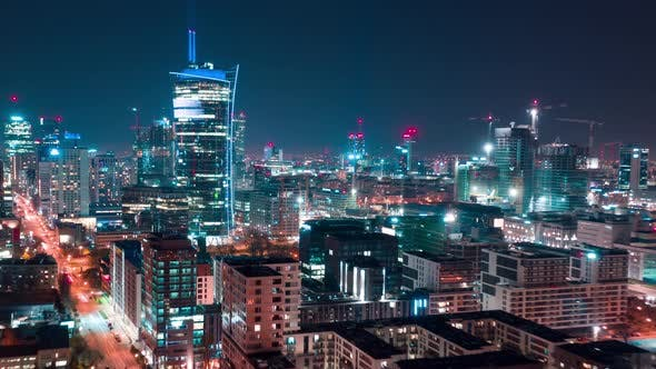 Thumbnail for Aerial Hyperlapse of Warsaw Business Center at Night: Skyscrapers and Palace of Science and Culture