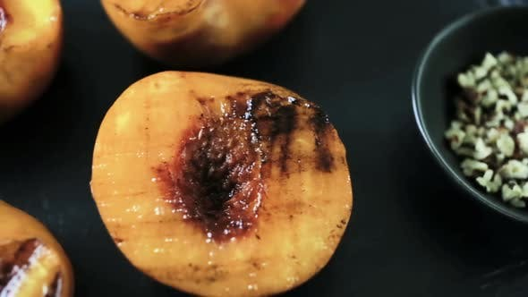 Thumbnail for Grilled organic peaches for dessert.