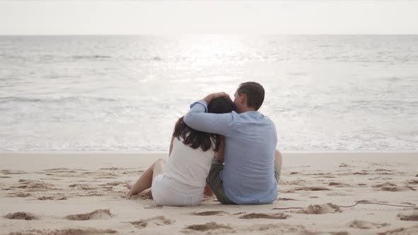 Young Lovers on Honeymoon Hugging at Beautiful Sea Beach