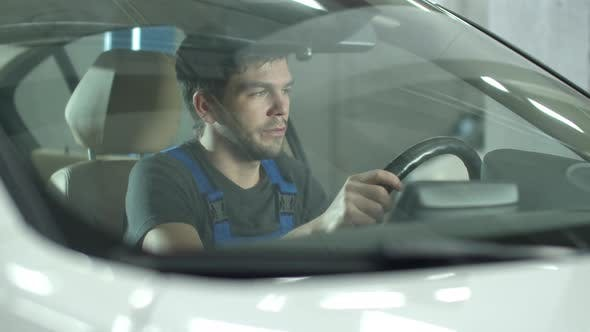 Thumbnail for Mechanic Sits in a Car and Imagines That Car Is His
