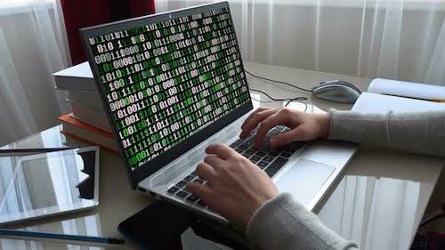 Binary code on the monitor screen