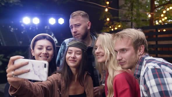 Friends Enjoying Rooftop Party, Posing and Making Funny Selfies