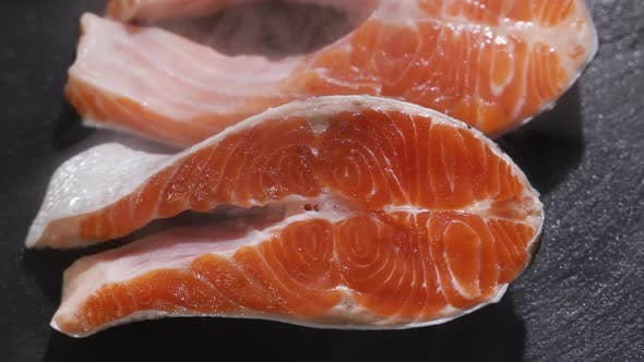 Thumbnail for Preparation of Salmon Steak. Spice and Salt Sprinkled on a Raw Piece of Salmon