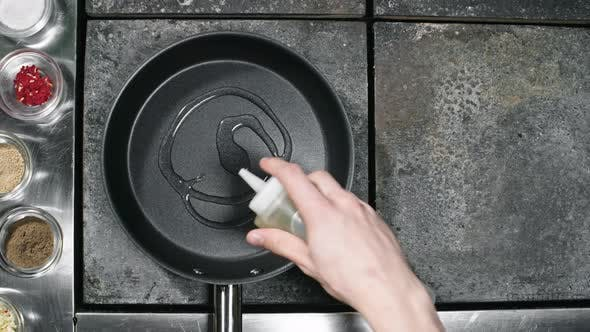 Thumbnail for Restaurant Cook Pouring Oil into Pan