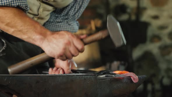 Thumbnail for Hand of a Blacksmith with a Hammer, Makes a Forged Product By Striking the Anvil