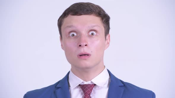 Thumbnail for Face of Young Handsome Businessman Looking Surprised