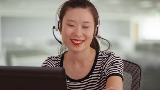 Thumbnail for Millennial sales woman looking at camera with big smile at call center