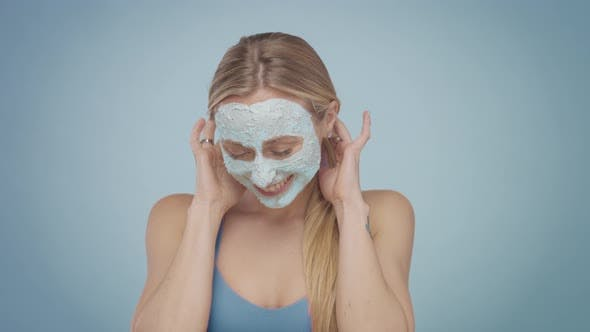 Thumbnail for Blonde Model in Studio Makes a Cleansing Facial Mask