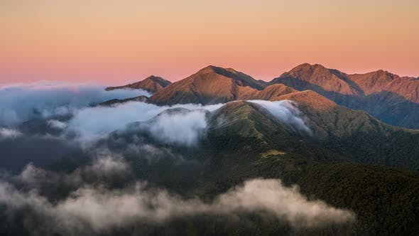 Thumbnail for Beautiful Evening Colors in Mabove Misty Clouds in New Zealand Nature