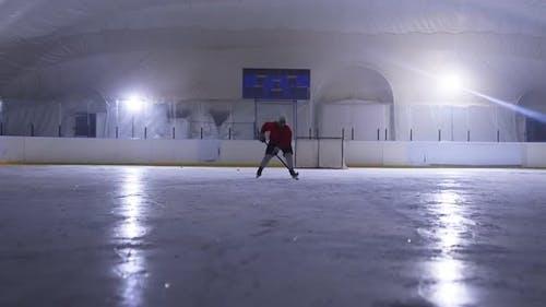 Silhouette Ice Arena Hockey Player