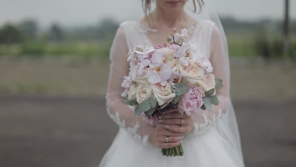 Cover Image for Wedding Bouquet in the Hands of the Bride. Wedding Day. Engagement