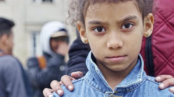 Thumbnail for Refugee Girl Looking into Camera